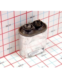 General Electric - 21L6011 - Capacitor, oil-filled. 1uF 660VAC 60Hz. Motor Run Capacitor, Used.